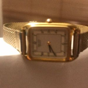 Gold banded watch